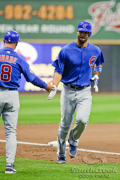 25 April 2010:  Chicago Cubs first baseman Derrek Lee (25) is congratulated by third base coach Mike Quade (8) after hitting a two run home run during the 4th inning of the game between the Milwaukee Brewers and Chicago Cubs at Miller Park in Milwaukee, Wisconsin.  The Cubs defeated the Brewers 12-2 to sweep the 3 game series.  Mandatory Credit: John Rowland / Southcreek Global