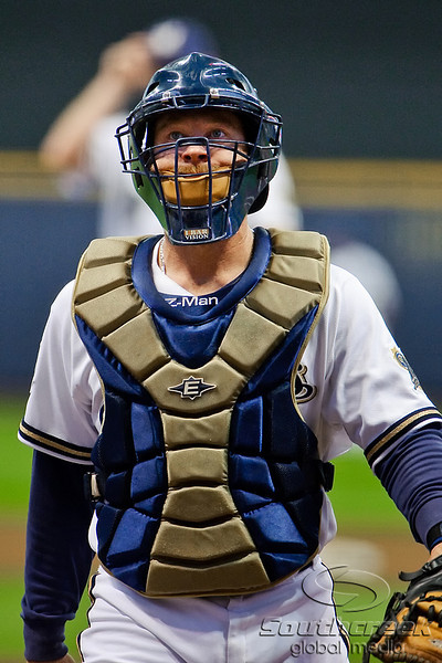 25 April 2010:  Milwaukee Brewers catcher Gregg Zaun (9) returns to the plate after talking to Milwaukee Brewers starting pitcher Dave Bush during the game between the Milwaukee Brewers and Chicago Cubs at Miller Park in Milwaukee, Wisconsin.  The Cubs defeated the Brewers 12-2 to sweep the 3 game series.  Mandatory Credit: John Rowland / Southcreek Global