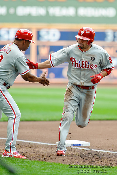 Philadelphia center fielder Shane Victorino (8) is congratulated by 3rd base coach Juan Samuel (12) after hitting a home run during the game between the Milwaukee Brewers and the Philadelphia Phillies at Miller Park in Milwaukee, WI. The Brewers defeated the Phillies 3-2 to end a five game losing streak.