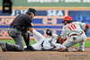 Milwaukee center fielder Nyjer Morgan (2) evades the tag of Philadelphia's Michael Martinez (19) during the game between the Milwaukee Brewers and the Philadelphia Phillies at Miller Park in Milwaukee, WI. The Brewers defeated the Phillies 3-2 to end a five game losing streak.