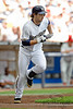 Milwaukee left fielder Ryan Braun (8) runs to first during the game between the Milwaukee Brewers and the Philadelphia Phillies at Miller Park in Milwaukee, WI. The Brewers defeated the Phillies 3-2 to end a five game losing streak.