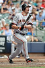 Featured as a full page photo in the Sports Illustrated SF Giants Commemorative Issue.  5 July 2010:  San Francisco Giants left fielder Aubrey Huff (17) hits a double during the 4th inning of the game between the Milwaukee Brewers and San Francisco Giants at Miller Park in Milwaukee, Wisconsin.  The Giants defeated the Brewers 6-1.  Mandatory Credit: John Rowland / Southcreek Global