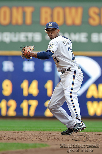 5 July 2010:  Milwaukee Brewers shortstop Alcides Escobar (21) sets to throw to first base during the game between the Milwaukee Brewers and San Francisco Giants at Miller Park in Milwaukee, Wisconsin.  The Giants defeated the Brewers 6-1.  Mandatory Credit: John Rowland / Southcreek Global