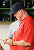 10 April 2010:   St. Louis Cardinals hitting coach Mark Mcguire goes over notes at the end of the game between the St. Louis Cardinals and Milwaukee Brewers at Miller Park in Milwaukee.  The Cardinals defeated the Brewers 7-1.  Mandatory Credit: John Rowland / Southcreek Global