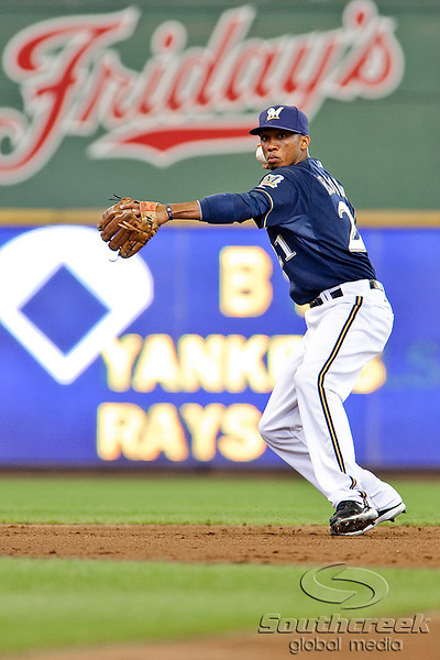 10 April 2010:  Milwaukee Brewers shortstop Alcides Escobar (21) makes a throw to first for an out during the game between the St. Louis Cardinals and Milwaukee Brewers at Miller Park in Milwaukee.  The Cardinals defeated the Brewers 7-1.  Mandatory Credit: John Rowland / Southcreek Global