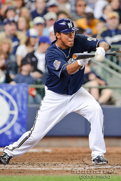 10 April 2010:   Milwaukee Brewers starting pitcher Yovani Gallardo (49) attempts to bunt during the game between the St. Louis Cardinals and Milwaukee Brewers at Miller Park in Milwaukee.  The Cardinals defeated the Brewers 7-1.  Mandatory Credit: John Rowland / Southcreek Global