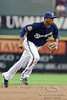 10 April 2010:   Milwaukee Brewers shortstop Alcides Escobar (21) makes a play on a ground ball during the game between the St. Louis Cardinals and Milwaukee Brewers at Miller Park in Milwaukee.  The Cardinals defeated the Brewers 7-1.  Mandatory Credit: John Rowland / Southcreek Global