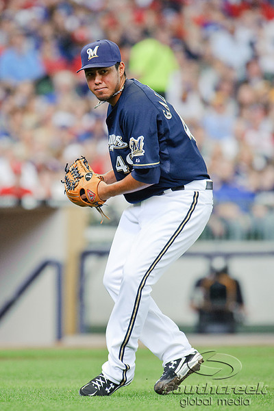 10 April 2010:   Milwaukee Brewers starting pitcher Yovani Gallardo (49) fields a ground ball and prepares to throw to first base during the game between the St. Louis Cardinals and Milwaukee Brewers at Miller Park in Milwaukee.  The Cardinals defeated the Brewers 7-1.  Mandatory Credit: John Rowland / Southcreek Global