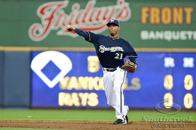 10 April 2010:   Milwaukee Brewers shortstop Alcides Escobar (21) makes a play to first base to beat out the base runner during the game between the St. Louis Cardinals and Milwaukee Brewers at Miller Park in Milwaukee.  The Cardinals defeated the Brewers 7-1.  Mandatory Credit: John Rowland / Southcreek Global