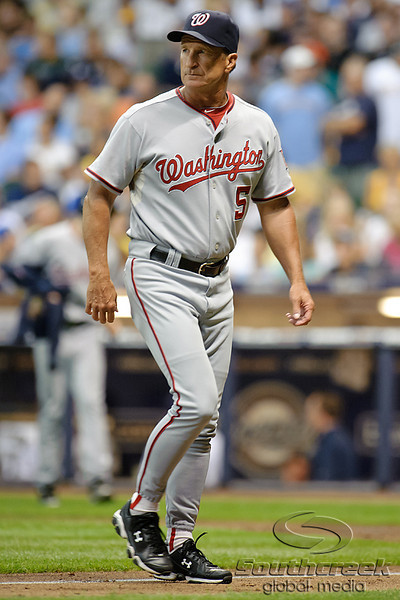 23 July 2010:  Washington Nationals manager Jim Riggleman (5) returns to the dugout after making a pitching change in the 6th inning of the game between the Milwaukee Brewers and Washington Nationals at Miller Park in Milwaukee, Wisconsin.  The Brewers defeated the Nationals 7-5.  Mandatory Credit: John Rowland / Southcreek Global