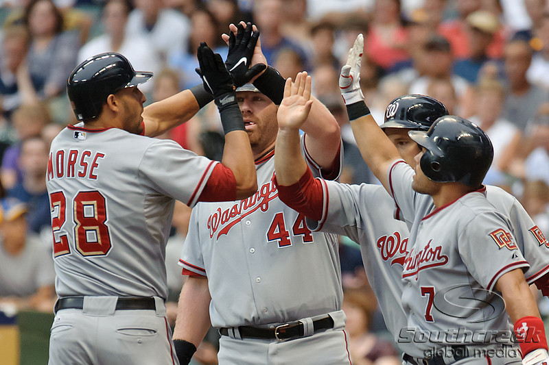23 July 2010:  Washington Nationals right fielder Michael Morse (28) is congratulated by teammates Adam Dunn (44) Ivan Rodriguez (7) and Josh Willingham after hitting a three run homerun in the 2nd inning of the game between the Milwaukee Brewers and Washington Nationals at Miller Park in Milwaukee, Wisconsin.  The Brewers defeated the Nationals 7-5.  Mandatory Credit: John Rowland / Southcreek Global