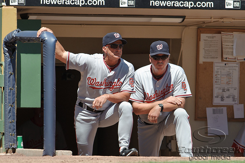 25 July 2010:  Washington Nationals manager Jim Riggleman (left) discusses strategy with pitching coach Steve McCatty (right) during the game between the Milwaukee Brewers and Washington Nationals at Miller Park in Milwaukee, Wisconsin.  The Brewers defeated the Nationals 8-3 to sweep the three game series.  Mandatory Credit: John Rowland / Southcreek Global