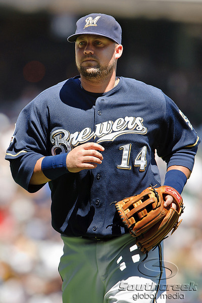 25 July 2010:  Milwaukee Brewers third baseman Casey McGehee (14) comes off the field in the middle of the 2nd inning of the game between the Milwaukee Brewers and Washington Nationals at Miller Park in Milwaukee, Wisconsin.  The Brewers defeated the Nationals 8-3 to sweep the three game series.  Mandatory Credit: John Rowland / Southcreek Global