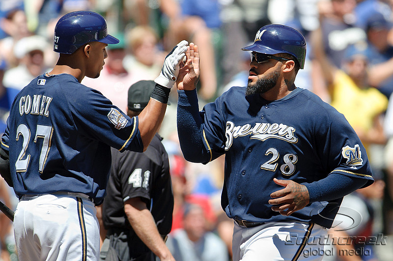 25 July 2010:  Milwaukee Brewers Prince Fielder (28) is congratulated by Milwaukee Brewers Carlos Gomez (27) after scoring on a wild pitch in the first inning of the game between the Milwaukee Brewers and Washington Nationals at Miller Park in Milwaukee, Wisconsin.  The Brewers defeated the Nationals 8-3 to sweep the three game series.  Mandatory Credit: John Rowland / Southcreek Global