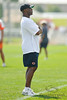 5 August 2010:  Chicago Bears Head Coach Lovie Smith watches over the Bears training camp practice at Olivet Nazarene University in Bourbonnais, IL.<br /> Mandatory Credit - John Rowland / Southcreek Global