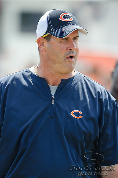 5 August 2010:  Offensive Line coach Mike Tice heads out to the field for the Chicago Bears training camp practice at Olivet Nazarene University in Bourbonnais, IL.<br /> Mandatory Credit - John Rowland / Southcreek Global