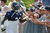5 August 2010:  Chicago Bears cornerback D.J. Moore (30) greets fans on his way to the field for the Bears training camp practice at Olivet Nazarene University in Bourbonnais, IL.<br /> Mandatory Credit - John Rowland / Southcreek Global