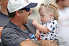 5 August 2010:  A Chicago Bears fan holds his daughter at the Bears training camp practice at Olivet Nazarene University in Bourbonnais, IL.<br /> Mandatory Credit - John Rowland / Southcreek Global