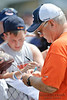 5 August 2010:  Offensive Coordinator Mike Martz signs autographs for the fans prior to the Chicago Bears training camp practice at Olivet Nazarene University in Bourbonnais, IL.<br /> Mandatory Credit - John Rowland / Southcreek Global