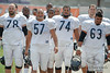5 August 2010:  Chicago Bears offensive linemen Kevin Shaffer (78), Olin Kreutz (57), Chris Williams (74), and Roberto Garza (63) head to the field for the training camp practice at Olivet Nazarene University in Bourbonnais, IL.<br /> Mandatory Credit - John Rowland / Southcreek Global
