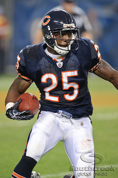 Chicago Bears running back Garrett Wolfe (25) runs with the ball during the preseason game between the Chicago Bears and the Oakland Raiders at Soldier Field in Chicago, IL. The Raiders defeated the Bears 32-17. <br /> Mandatory Credit: John Rowland / Southcreek Global