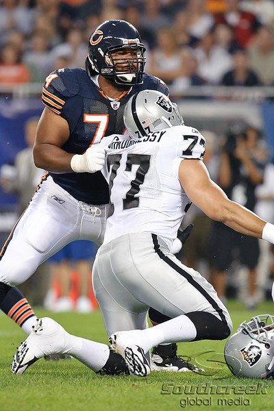 Chicago Bears offensive tackle Chris Williams (74) tries to block Oakland Raiders defensive end Matt Shaughnessy (77) during the preseason game between the Chicago Bears and the Oakland Raiders at Soldier Field in Chicago, IL. The Raiders defeated the Bears 32-17. <br /> Mandatory Credit: John Rowland / Southcreek Global