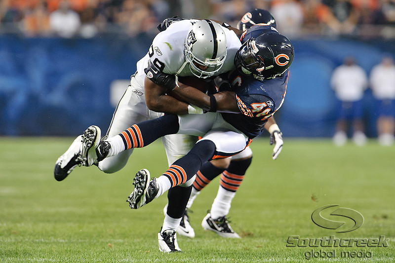 Oakland Raiders running back Michael Bush (29) is tackled by Chicago Bears safety Chris Harris (46) during the preseason game between the Chicago Bears and the Oakland Raiders at Soldier Field in Chicago, IL. The Raiders defeated the Bears 32-17. <br /> Mandatory Credit: John Rowland / Southcreek Global