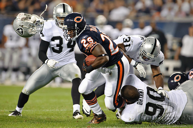 Chicago Bears running back Chester Taylor (29) is brought down by Oakland Raiders defensive tackle Desmond Bryant (90) during the preseason game between the Chicago Bears and the Oakland Raiders at Soldier Field in Chicago, IL. The Raiders defeated the Bears 32-17. <br /> Mandatory Credit: John Rowland / Southcreek Global