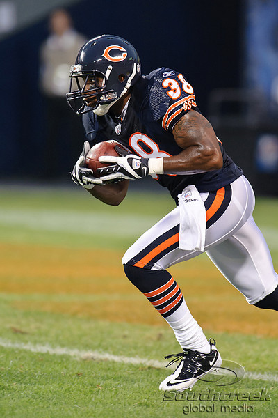 Chicago Bears safety Danieal Manning (38) runs back a kickoff during the 1st quarter of the preseason game between the Chicago Bears and the Oakland Raiders at Soldier Field in Chicago, IL. The Raiders defeated the Bears 32-17. <br /> Mandatory Credit: John Rowland / Southcreek Global