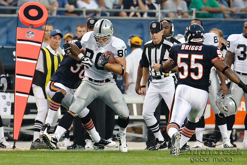 Oakland Raiders tight end Zach Miller (80) tires to break the tackle of Chicago Bears safety Danieal Manning (38) after making a catch during the 1st quarter of the preseason game between the Chicago Bears and the Oakland Raiders at Soldier Field in Chicago, IL. The Raiders defeated the Bears 32-17. <br /> Mandatory Credit: John Rowland / Southcreek Global