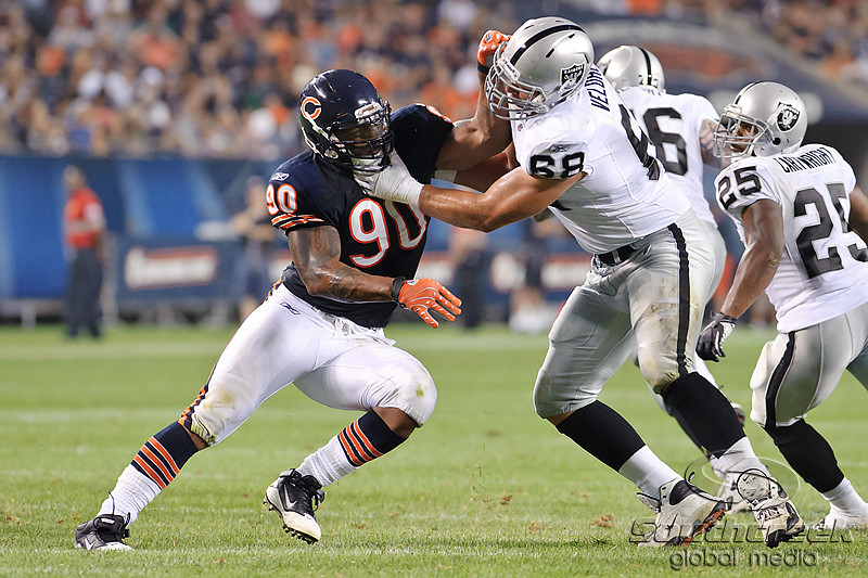 Oakland Raiders offensive tackle Jared Veldheer (68) attempts to block the pass rush of Chicago Bears defensive end Julius Peppers (90) during the preseason game between the Chicago Bears and the Oakland Raiders at Soldier Field in Chicago, IL. The Raiders defeated the Bears 32-17. <br /> Mandatory Credit: John Rowland / Southcreek Global