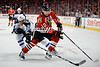 Chicago left wing Patrick Sharp (10) and Winnipeg defenseman Dustin Byfuglien (33) battle for the puck during the NHL game between the Chicago Blackhawks and the Winnipeg Jets at the United Center in Chicago, IL. The Blackhawks defeated the Jets 4-3.