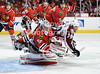 Chicago goalie Corey Crawford (50) makes a save while Colorado left wing T.J. Galiardi (39) and Chicago defenseman Steve Montador (5) battle for the rebound during the NHL game between the Chicago Blackhawks and the Colorado Avalanche at the United Center in Chicago, IL. The Avs defeated the Blackhawks 5-4 in a shootout.