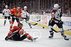 Chicago defenseman Nick Leddy (8) is knocked to the ice while battling Colorado right wing Milan Hejduk (23) for the puck during the NHL game between the Chicago Blackhawks and the Colorado Avalanche at the United Center in Chicago, IL. The Avs defeated the Blackhawks 5-4 in a shootout.