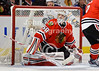 Chicago goalie Corey Crawford (50) loos for the puck after making a save during the NHL game between the Chicago Blackhawks and the Buffalo Sabres at the United Center in Chicago, IL. The Blackhawks defeated the Sabres 6-2.