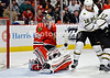 Chicago goalie Corey Crawford (50) makes a save while Dallas right wing Adam Burish (16) looks for the rebound during the NHL game between the Chicago Blackhawks and the Dallas Stars at the United Center in Chicago, IL. The Stars defeated the Blackhawks 3-1.