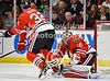 Chicago goalie Corey Crawford (50) makes a save during the NHL game between the Chicago Blackhawks and the Detroit Red Wings at the United Center in Chicago, IL. The Blackhawks defeated the Red Wings 2-1.