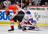 New York goalie Henrik Lundqvist (30) makes a save on a shot by Chicago right wing Jamal Mayers (22) during the NHL game between the Chicago Blackhawks and the New York Rangers at the United Center in Chicago, IL. The Blackhawks defeated the Rangers 4-3.