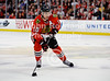 Chicago left wing Patrick Sharp (10) brings the puck up ice during the NHL game between the Chicago Blackhawks and the New York Rangers at the United Center in Chicago, IL. The Blackhawks defeated the Rangers 4-3.