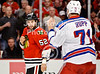 Chicago left wing Brandon Bollig (52) and New York left wing Mike Rupp (71) square off to fight during the NHL game between the Chicago Blackhawks and the New York Rangers at the United Center in Chicago, IL. The Blackhawks defeated the Rangers 4-3.