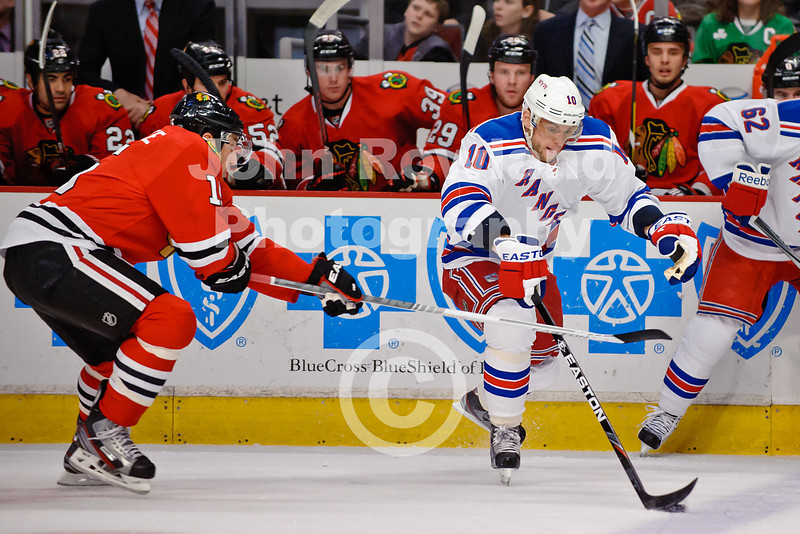 New York right wing Marian Gaborik (10) skates past Chicago left wing Andrew Brunette (15) during the NHL game between the Chicago Blackhawks and the New York Rangers at the United Center in Chicago, IL. The Blackhawks defeated the Rangers 4-3.