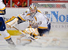 Nashville goalie Pekka Rinne (35) looks for a rebound after making a save during the NHL game between the Chicago Blackhawks and the Nashville Predators at the United Center in Chicago, IL. The Predators defeated the Blackhawks 3-1.