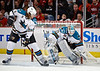 San Jose goalie Antti Niemi (31) makes a save and covers the puck while San Jose defenseman Douglas Murray (3) watches during the NHL game between the Chicago Blackhawks and the San Jose Sharks at the United Center in Chicago, IL. The Blackhawks defeated the Sharks 4-3.