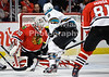Chicago goalie Ray Emery (30) makes a save on a redirect by San Jose center Joe Pavelski (8) during the NHL game between the Chicago Blackhawks and the San Jose Sharks at the United Center in Chicago, IL. The Blackhawks defeated the Sharks 3-2 in overtime.