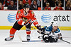 Chicago defenseman Niklas Hjalmarsson (4) and San Jose left wing Ryane Clowe (29) battle for a loose puck during the NHL game between the Chicago Blackhawks and the San Jose Sharks at the United Center in Chicago, IL. The Blackhawks defeated the Sharks 3-2 in overtime.