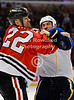Chicago right wing Jamal Mayers (22) and St. Louis right wing B.J. Crombeen (26) fight during the NHL game between the Chicago Blackhawks and the St Louis Blues at the United Center in Chicago, IL. The Blackhawks defeated the Blues 4-3 in a shootout.