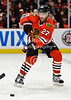 Chicago defenseman Johnny Oduya (27) passes the puck during the NHL game between the Chicago Blackhawks and the St Louis Blues at the United Center in Chicago, IL. The Blackhawks defeated the Blues 4-3 in a shootout.