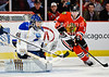 St. Louis goalie Jaroslav Halak (41) makes a save while Chicago center Marcus Kruger (16) goes after the rebound during the NHL game between the Chicago Blackhawks and the St Louis Blues at the United Center in Chicago, IL. The Blackhawks defeated the Blues 4-3 in a shootout.