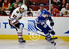Chicago defenseman Johnny Oduya (27) steals the puck from Toronto left wing Matt Frattin (39) during the NHL game between the Chicago Blackhawks and the Toronto Maple Leafs at the United Center in Chicago, IL. The Blackhawks defeated the Leafs 5-4.