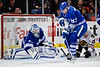 Toronto defenseman Dion Phaneuf (3) clears a rebound after goalie Jonas Gustavsson (50) makes a save during the NHL game between the Chicago Blackhawks and the Toronto Maple Leafs at the United Center in Chicago, IL. The Blackhawks defeated the Leafs 5-4.